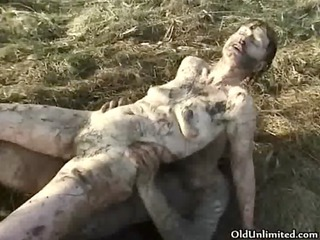 Horny mature housewife covered with mud