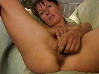 Skinny brunette milf in red undies plays with her