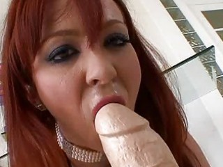 Horny redhead milf playing with huge sex toy
