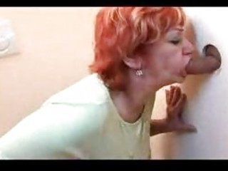 Redhead mature banged through gloryhole