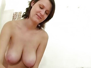 mature girl with big tits gives a handjob