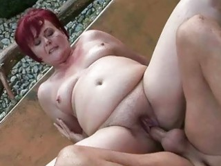 Fat grandma gets her pussy fucked outdoor