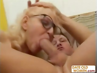 Blonde grandmother mouths a younger cock and then