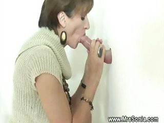 Cuckold sees busty wife sucking gloryhole dick