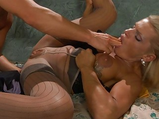 Tanned blonde milf in pantyhose takes on hard