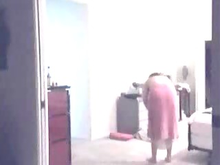 Mature woman undressing - spy cam