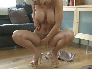 Sensual blonde momma with big tits in heels