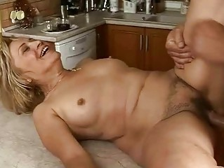Lusty granny gets fucked hard in the kitchen