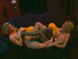 Two busty blonde milfs in pantyhose with a foot