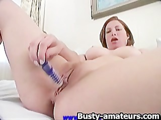 Ginger toying her pussy on the bed