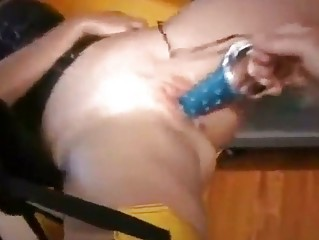 Blindfolded MILF squirts with dildo
