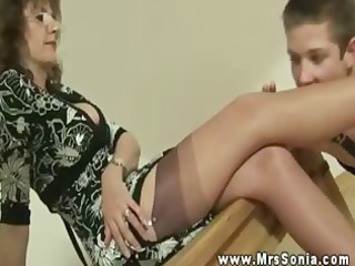 Hot busty mature makes young dude foot worship her