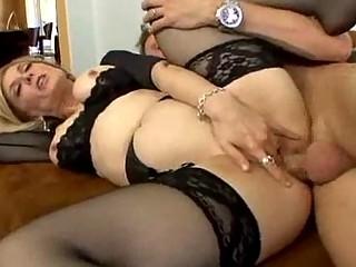 Stocking clad milf loves spreading her legs for