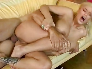 Blonde momma with big boobs takes dick up her