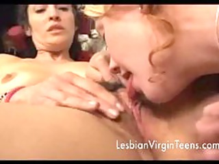 Teen girl licking mature and hairy pussy