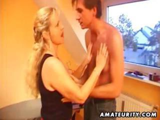Busty amateur blonde MILF blows his rod, fucks