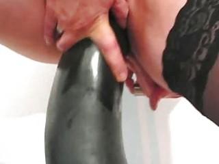 Frustrated wife fucking gigantic dildos