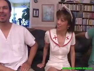 My mom in nurse uniform sucks three cocks