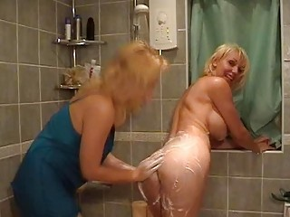 Sexy blonde mommas with great tits having fun in