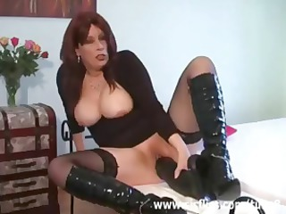 Busty brunette MILF in hot lingerie uses big toys