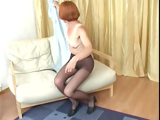 Redhead granny in pantyhose reaches in to rub her
