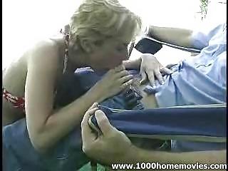 amateur Milf giving blowjob outdoors
