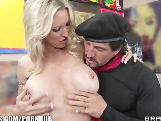 Mature blonde MILF shows off her pierced nipples