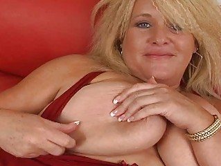 Huge blonde momma with massive bosom masturbates