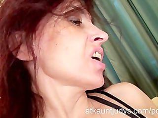 Sexy Milf Karolina masturbates wearing black