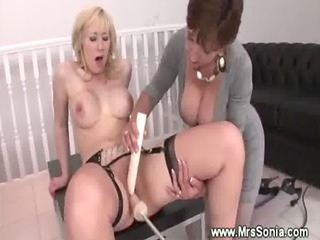 Busty milf helps lady reach an orgasm