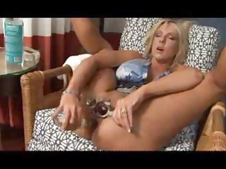 Busty blonde MILF uses a huge dildo on her pussy