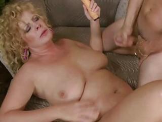 Busty mature lady slurps on giant fat prick