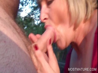 Outdoor blowjob with blonde mature