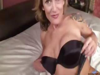 Busty blonde MILF gets naked and rubs and dildos
