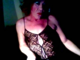 Mature crossdresser sucking solo