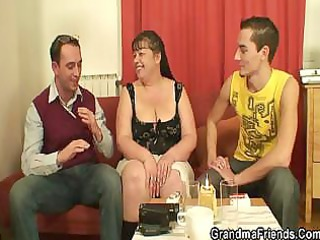 Fat mature babe takes two young cocks