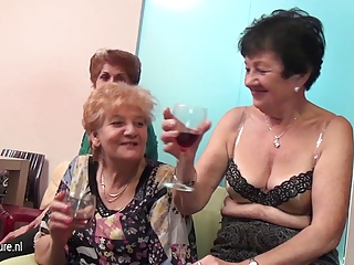 Old and young lesbians perform in a room full of