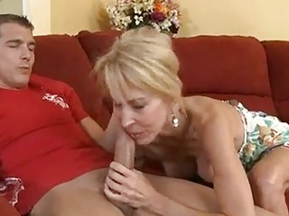 Hot mature Erica Lauren fills her mouth with a