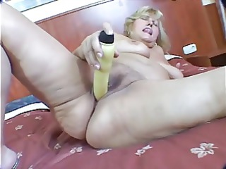 Fat blonde mature masturbation on bed