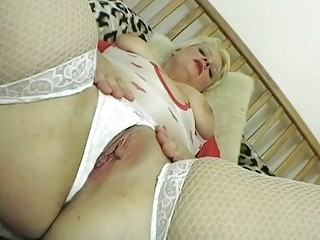 Naughty blonde MILF lady posing in sexy lingerie