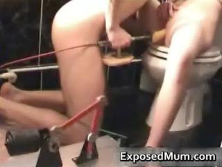 Mom stuffed with dildo machine and sucks